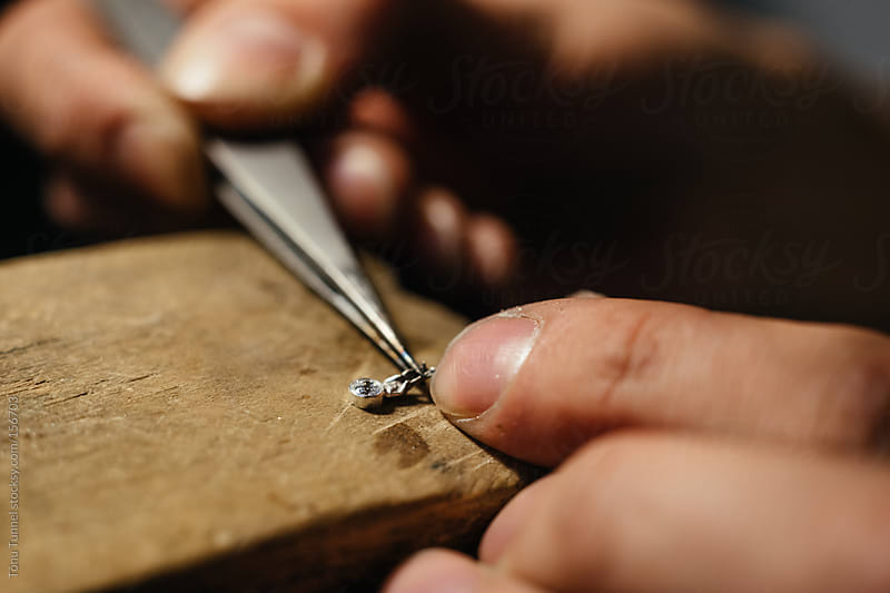 A closeup of a jeweller working by Tõnu Tunnel for Stocksy United
