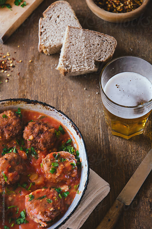 Meatballs with tomato sauce by Pixel Stories for Stocksy United