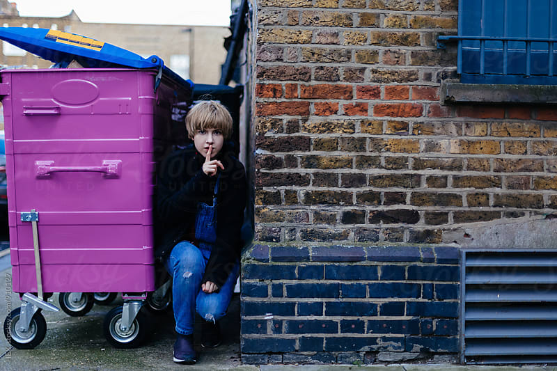 Young Woman Hiding on the Street of London by HEX. for Stocksy United