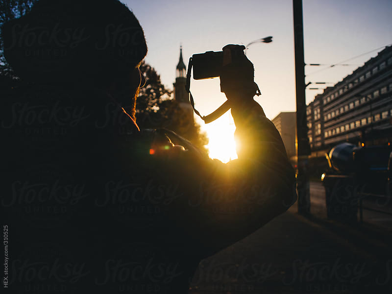 Man taking a Sunset Picture in the City by HEX. for Stocksy United