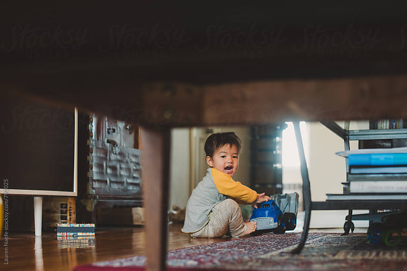 Baby playing with toys by Lauren Naefe for Stocksy United