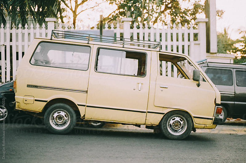 VIntage van parked on the side of the road by Douglas Robichaud for Stocksy United