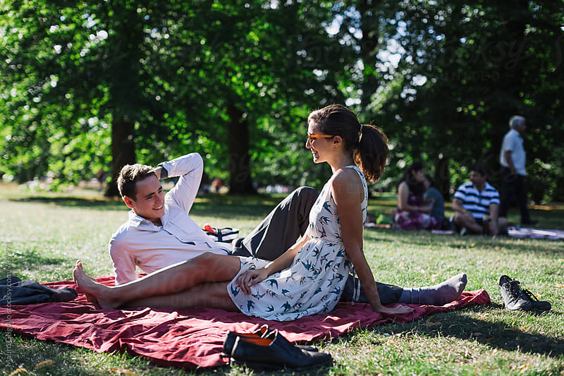 Couple meeting at the park by Mauro Grigollo for Stocksy United