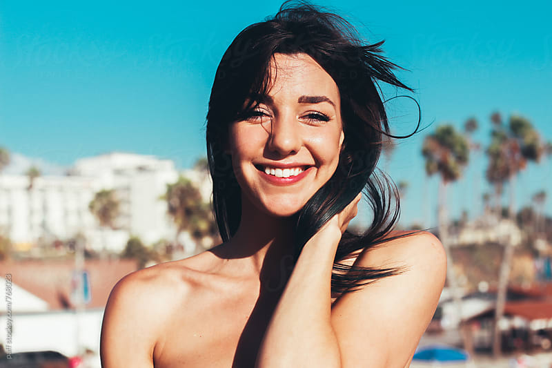 Portrait of a beautiful young woman with cute smile by paff for Stocksy United