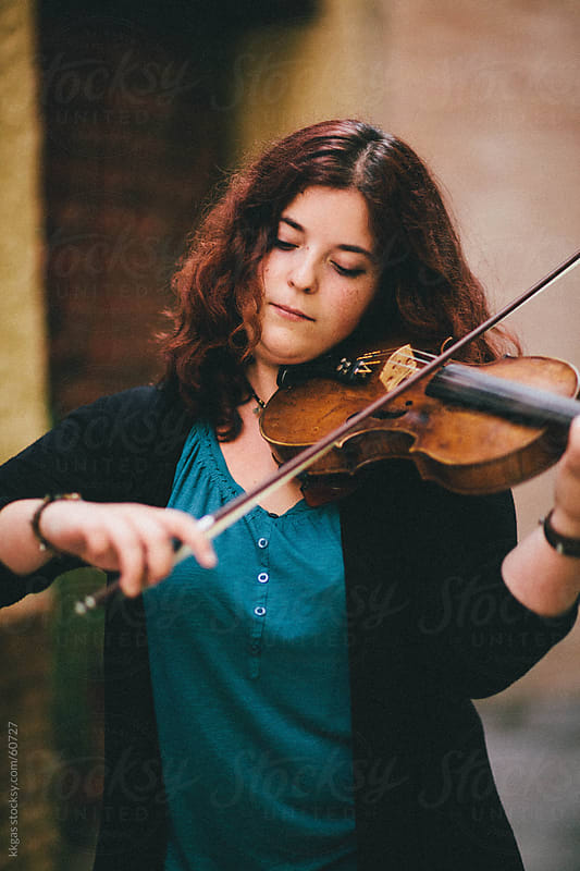 Young woman playing a violin by kkgas for Stocksy United