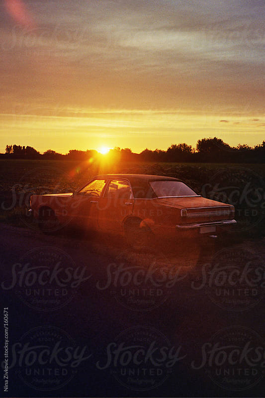 A vintage car in the sunset. by Nina Zivkovic for Stocksy United