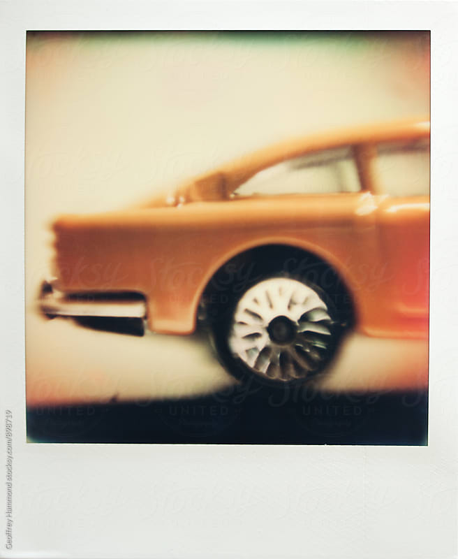 Polaroid Macro Photo of Toy Car, Rear Side by Geoffrey Hammond for Stocksy United