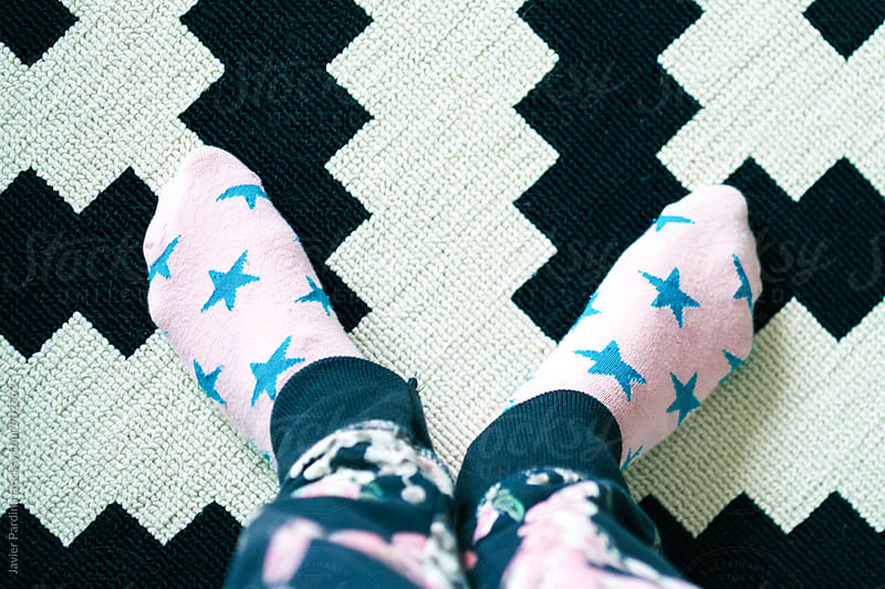child's feet on the carpet by Javier Pardina for Stocksy United