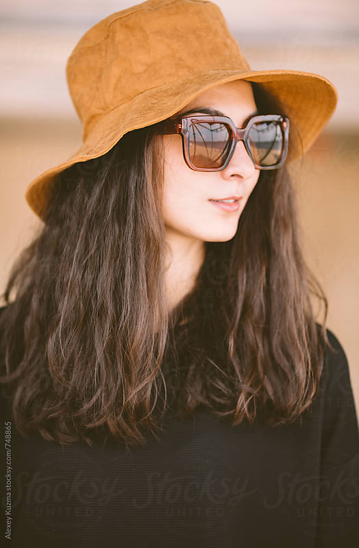 portrait of real young woman with hat and sunglasses  by Vesna for Stocksy United