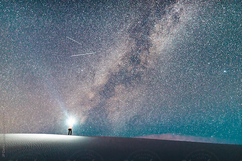 Man Standing on Sand Dune With Flashlight and Milky Way Galaxy in White Sands National Monument NM by JP Danko for Stocksy United