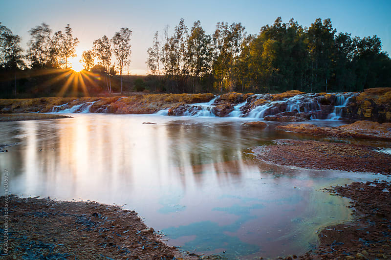 Waterfall and sun in the Red River by ACALU Studio for Stocksy United