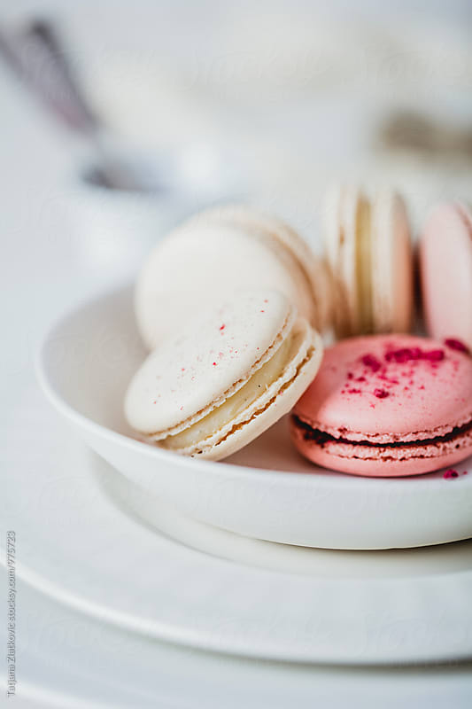 Vanilla and raspberry macarons by Tatjana Ristanic for Stocksy United