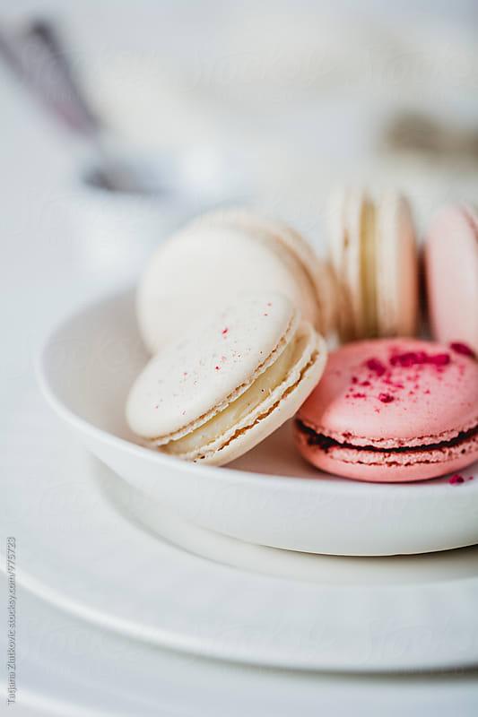 Vanilla and raspberry macarons by Tatjana Zlatkovic for Stocksy United