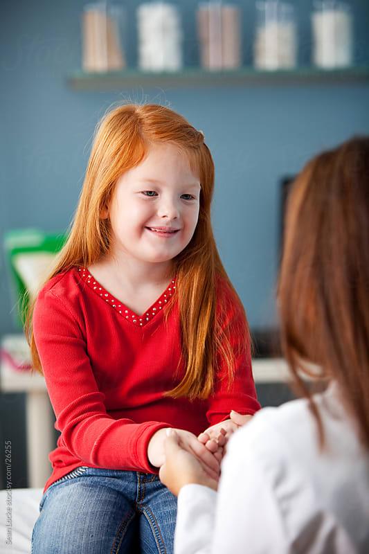 Exam Room: Checking Reflexes of Little Girl by Sean Locke for Stocksy United