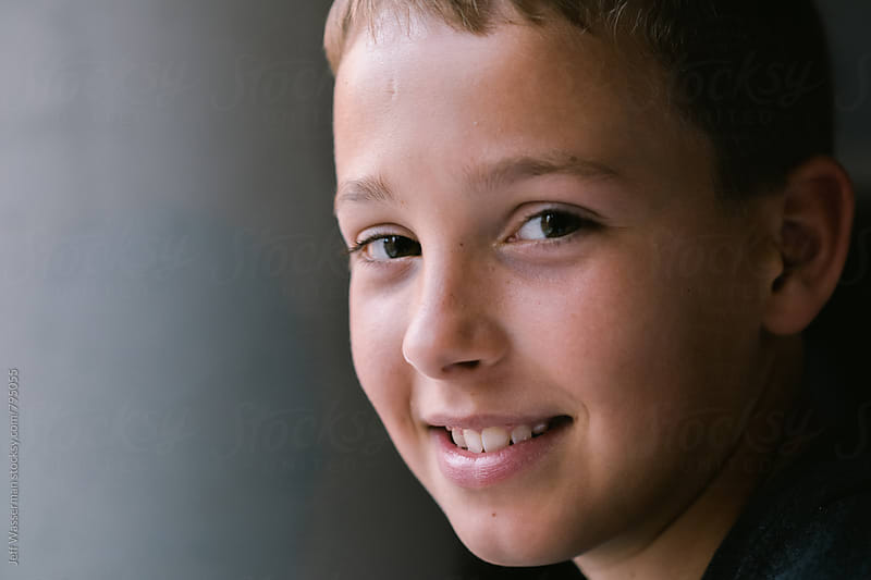 Smiling Portait of Eleven-Year-Old Boy by Jeff Wasserman for Stocksy United