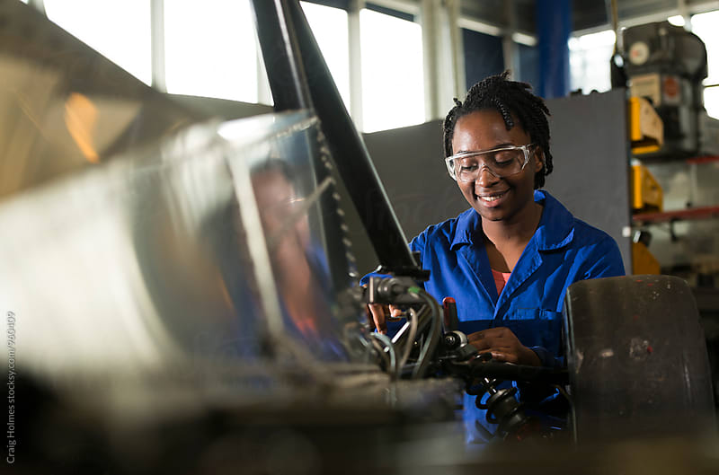 Woman working in engineering. by Craig Holmes for Stocksy United