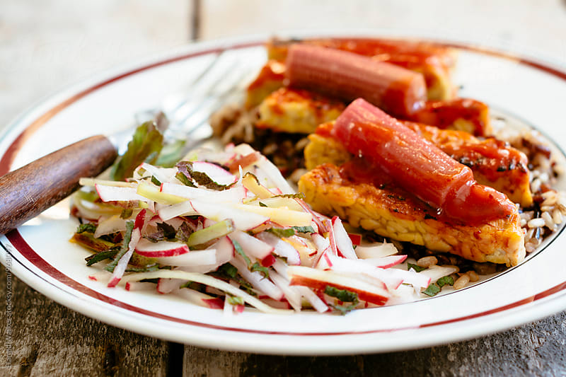 Tempeh with Rhubarb Barbecue Sauce  by Harald Walker for Stocksy United