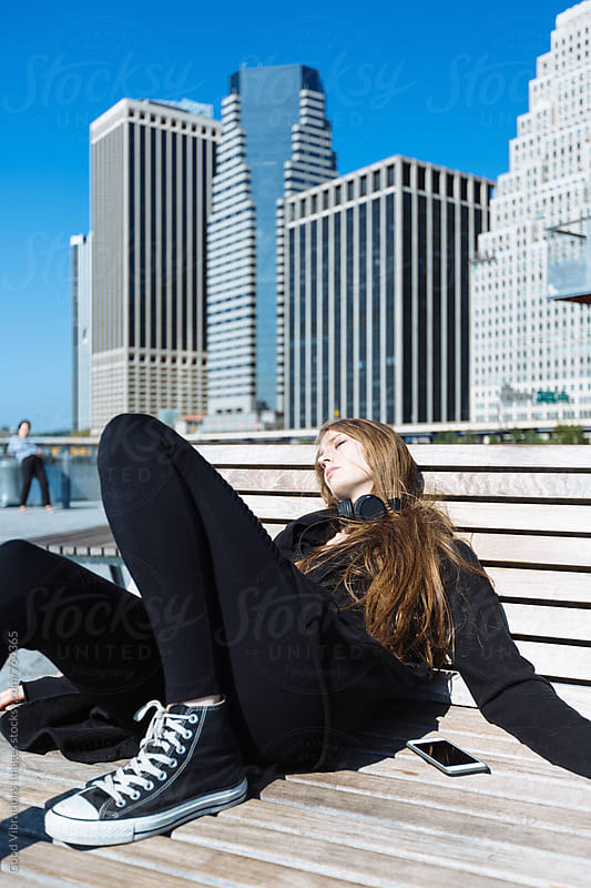 Woman sunbathing in Manhattan by Good Vibrations Images for Stocksy United