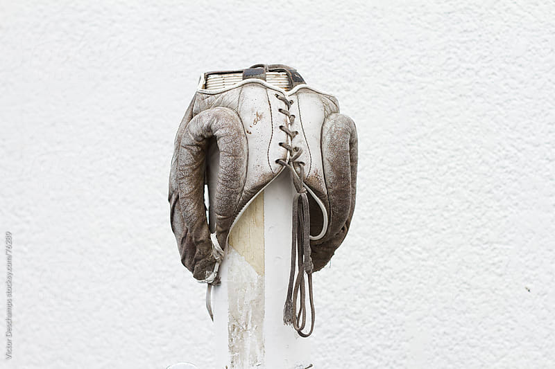 Worn boxing head guard on a stick. by Victor Deschamps for Stocksy United