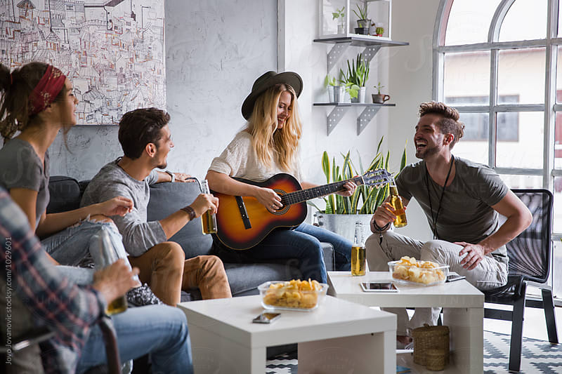 Group of friends having fun at home by Jovo Jovanovic for Stocksy United