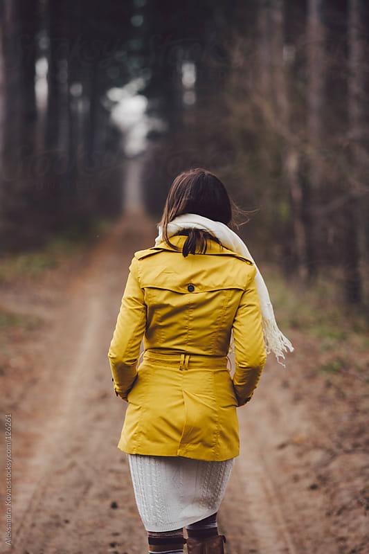 Woman walks in autumn nature by Aleksandra Kovac for Stocksy United