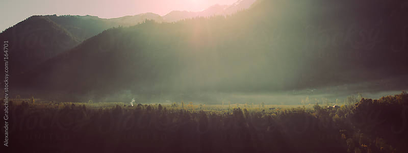 sunrise in Himalayan mountain valley  by Alexander Grabchilev for Stocksy United