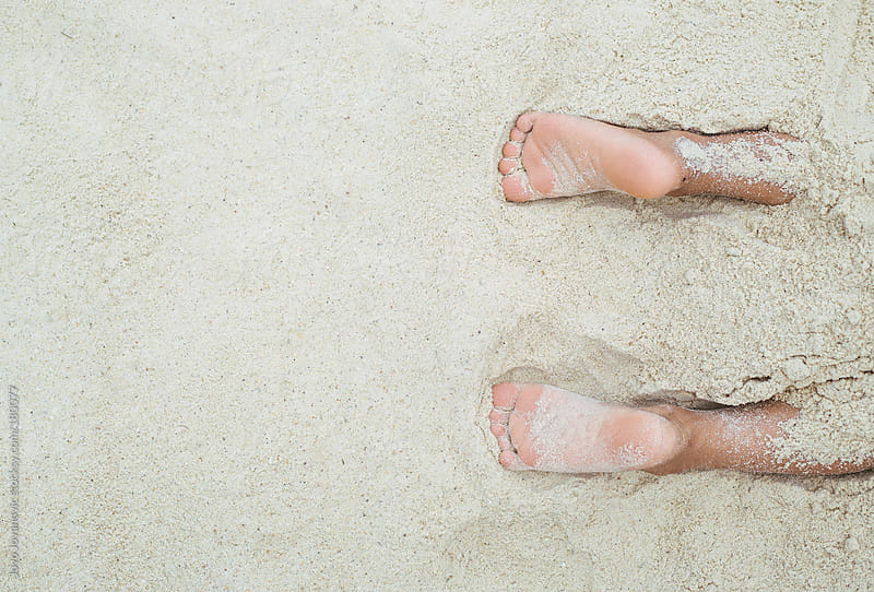 Kids feet covered with sand by Jovo Jovanovic for Stocksy United