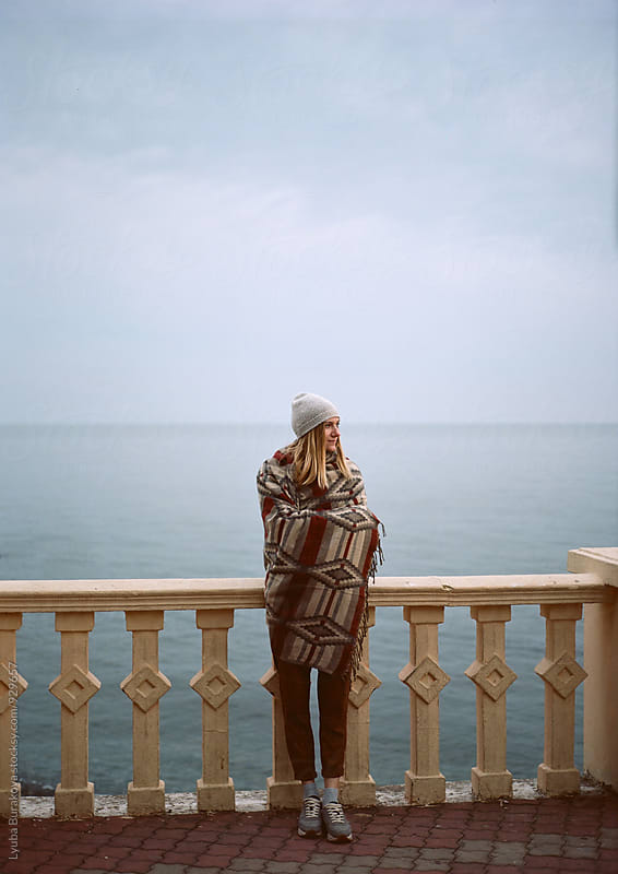 Young woman at seaside by Lyuba Burakova for Stocksy United