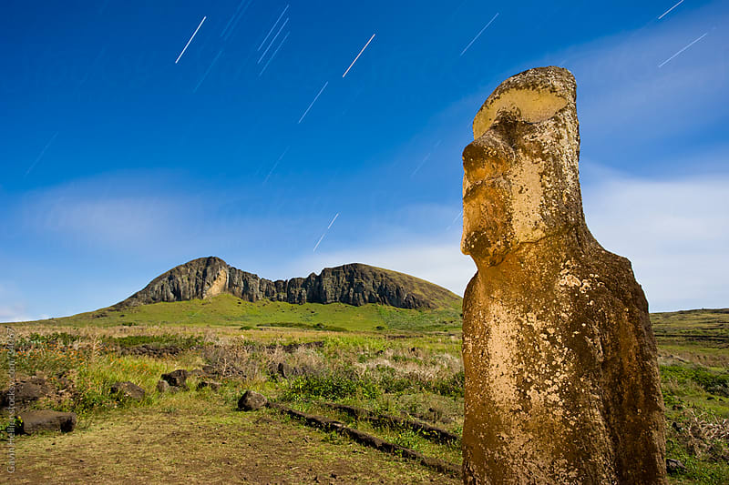South America, Chile, Rapa Nui, Isla de Pascua (Easter Island), lone monolithic giant stone Moai statue illuminated with moonlight at Tongariki by Gavin Hellier for Stocksy United
