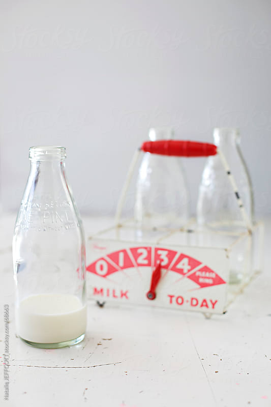 milk in bottle  by Natalie JEFFCOTT for Stocksy United