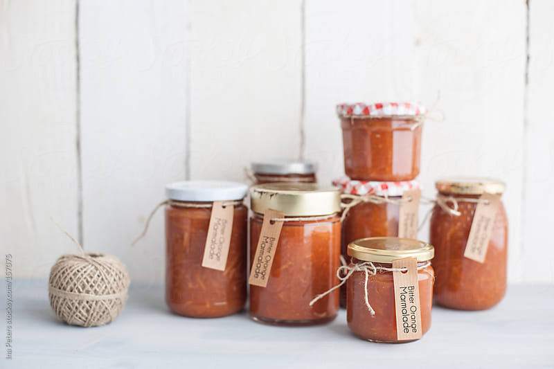 Food: Homemade Bitter Orange Marmalade in Jars by Ina Peters for Stocksy United