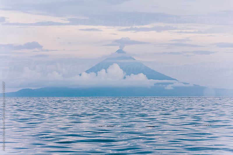 Volcano or mount Mayon blue silhouette and sea, Luzon, Philippines by Alejandro Moreno de Carlos for Stocksy United