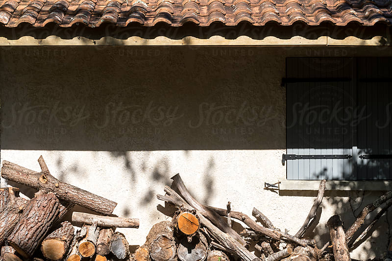 Logs and the French farmhouse by James Tarry for Stocksy United