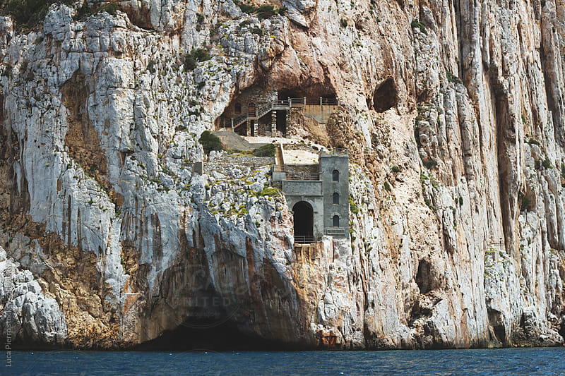 Awesome mine building on a cliff by Luca Pierro for Stocksy United