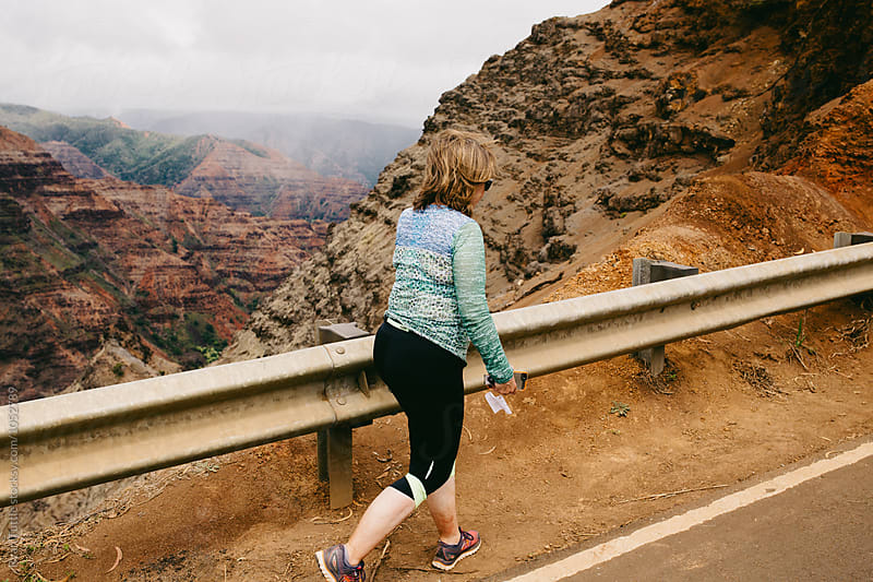 Woman at Waimea Canyon by Ryan Tuttle for Stocksy United