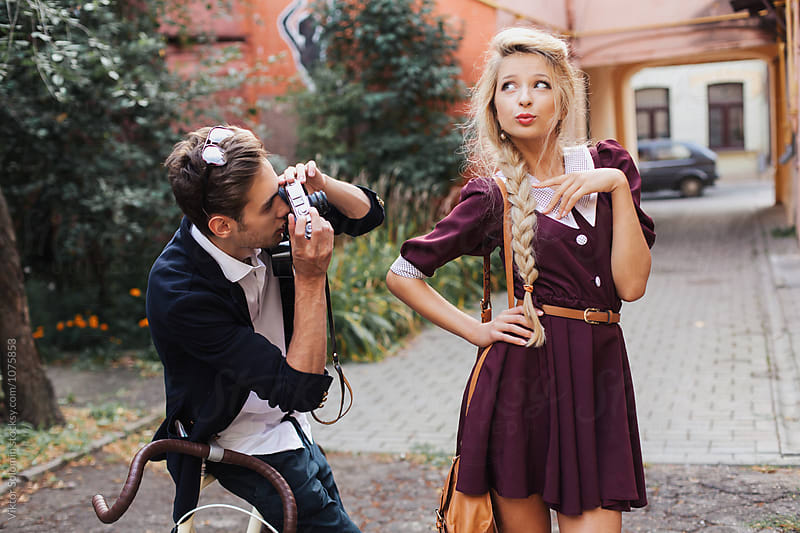 Vintage style photographer makes photos of pretty blonde model outdoor in summer by Viktor Solomin for Stocksy United