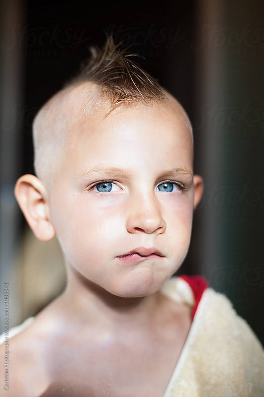 Five year old boy with freshly cut mohawk  by Carleton Photography for Stocksy United