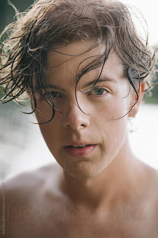 A portrait of a handsome young man with wet hait by Ania Boniecka for Stocksy United
