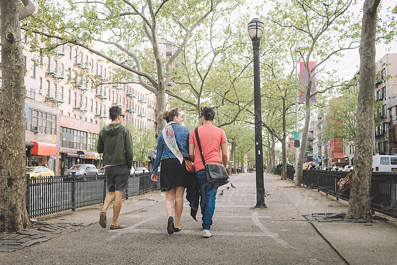 Three Friends in Casual Walking Leisurely in New York Lower East Side by Joselito Briones for Stocksy United