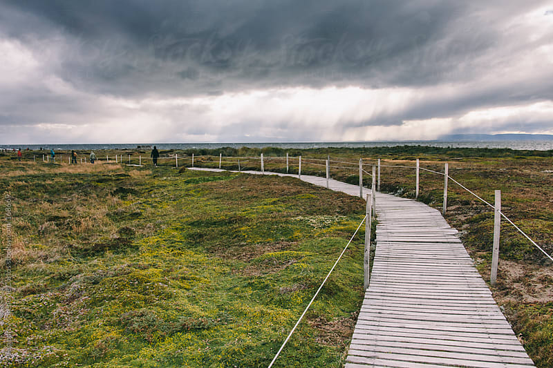 Passage on a field with storm clouds in Patagonia, Chile by Alejandro Moreno de Carlos for Stocksy United