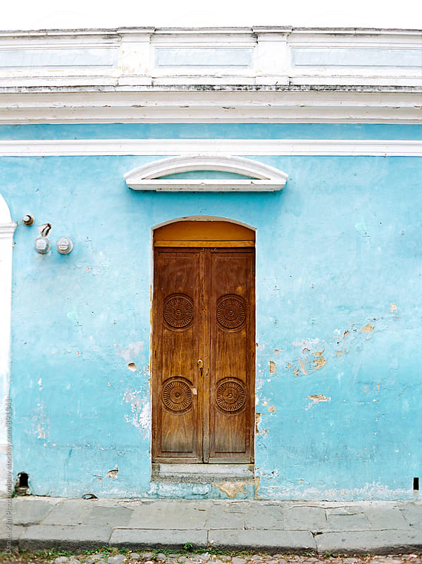 Old wood door and blue walls by Daniel Kim Photography for Stocksy United
