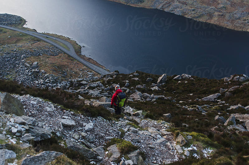 Female Hiker Decending Mountainside by Neil Warburton for Stocksy United