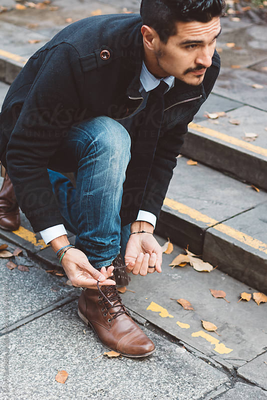 Man ties the shoelaces by Good Vibrations Images for Stocksy United