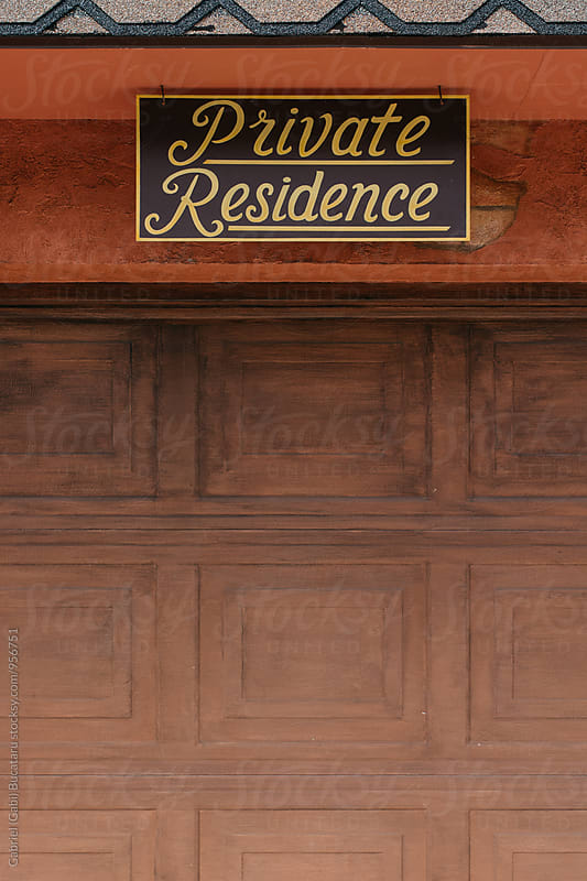 Private residence sign above a garage door by Gabriel (Gabi) Bucataru for Stocksy United
