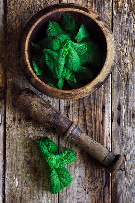 Mint leaves in mortar by Pixel Stories for Stocksy United