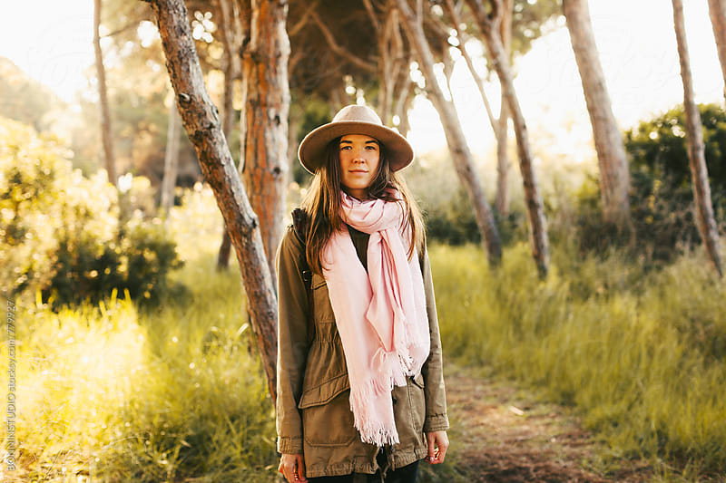Portrait of a hipster woman in the forest in autumn. by BONNINSTUDIO for Stocksy United