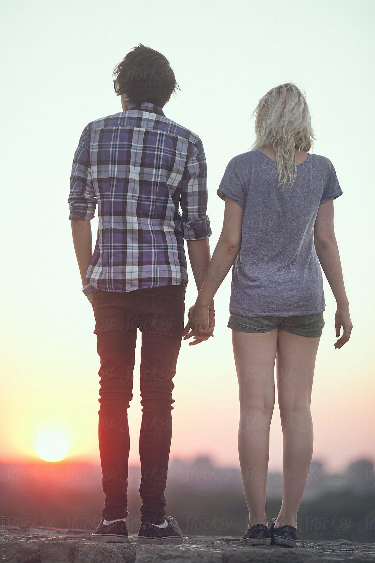 Teenage Couple Holding Hands | Stocksy United
