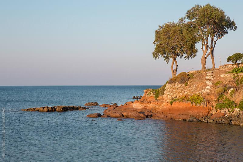 Limnionas beach at the sunset, Kythira, Greece. by Alberto Bogo for Stocksy United