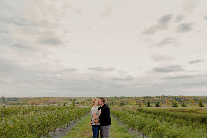 Beautiful couple kissing by Carey Shaw for Stocksy United