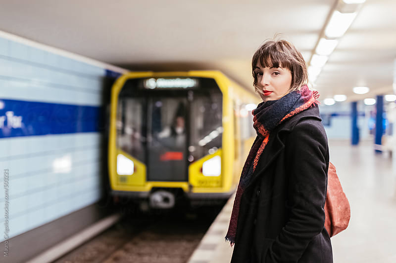 Woman using subway train in Berlin. Germany. by Mauro Grigollo for Stocksy United